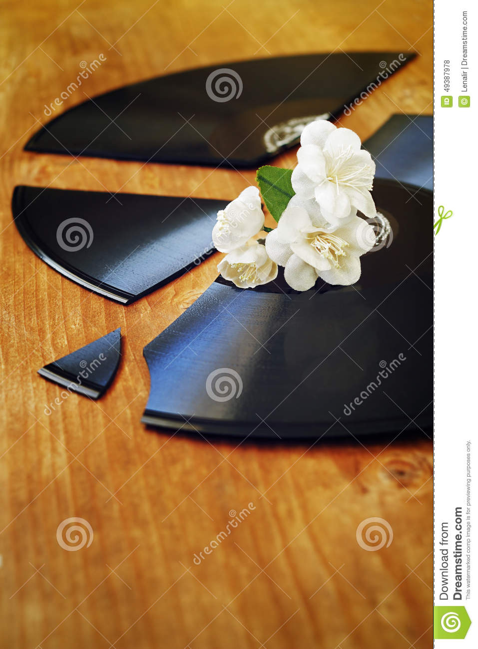 Artificial flowers on a record