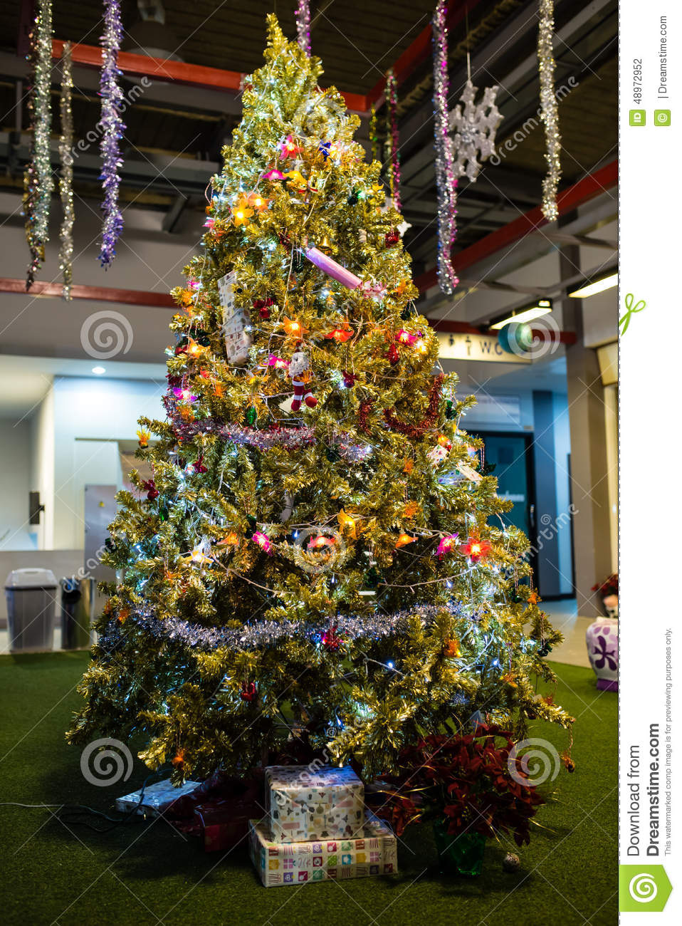 Christmas tree with presents and lights - Artificial Green Christmas Tree Lots Of Presents Under The Tree Stock Photo