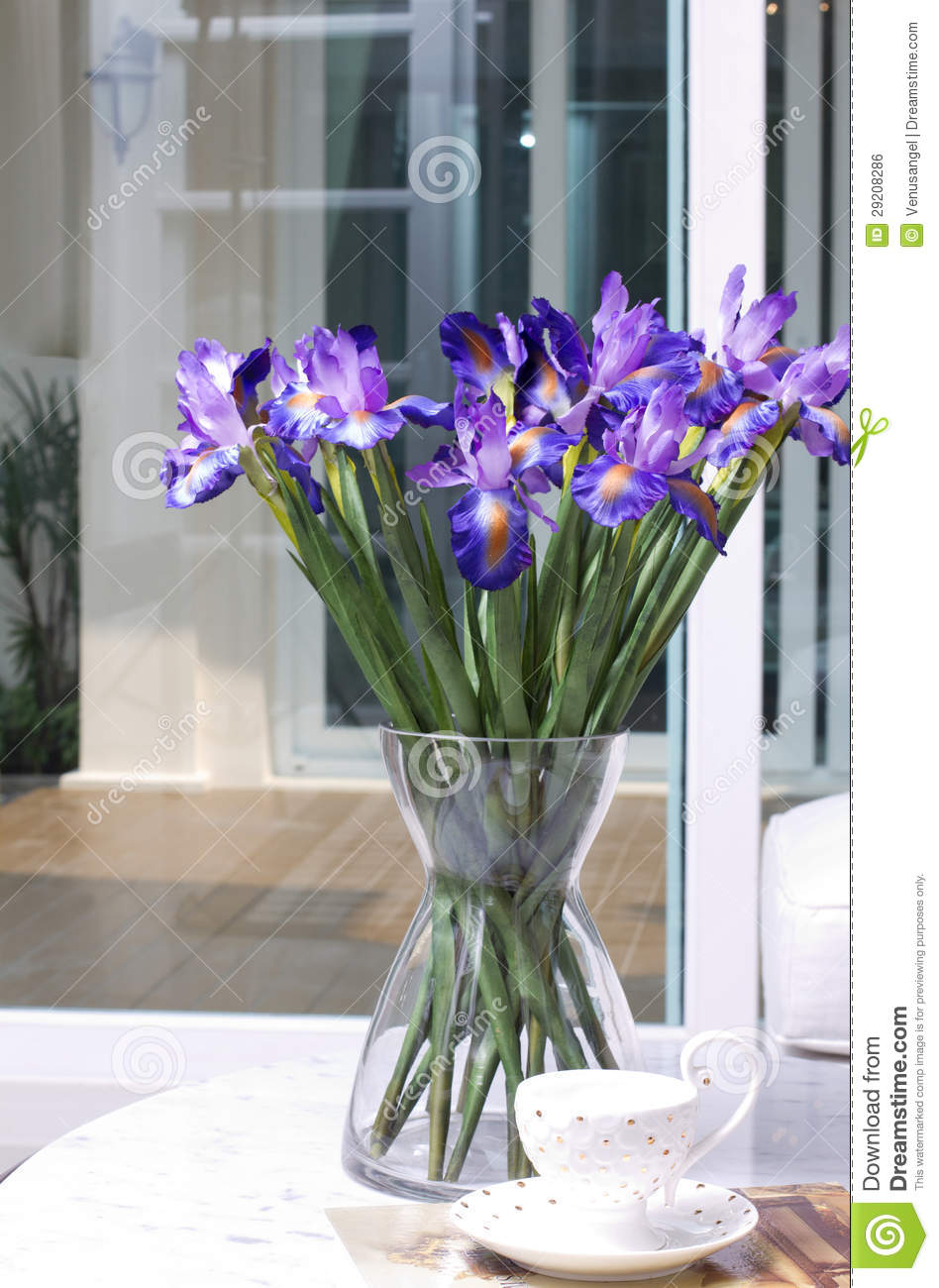 Artificial Iris Flowers In A Glass Vase Royalty Free Stock
