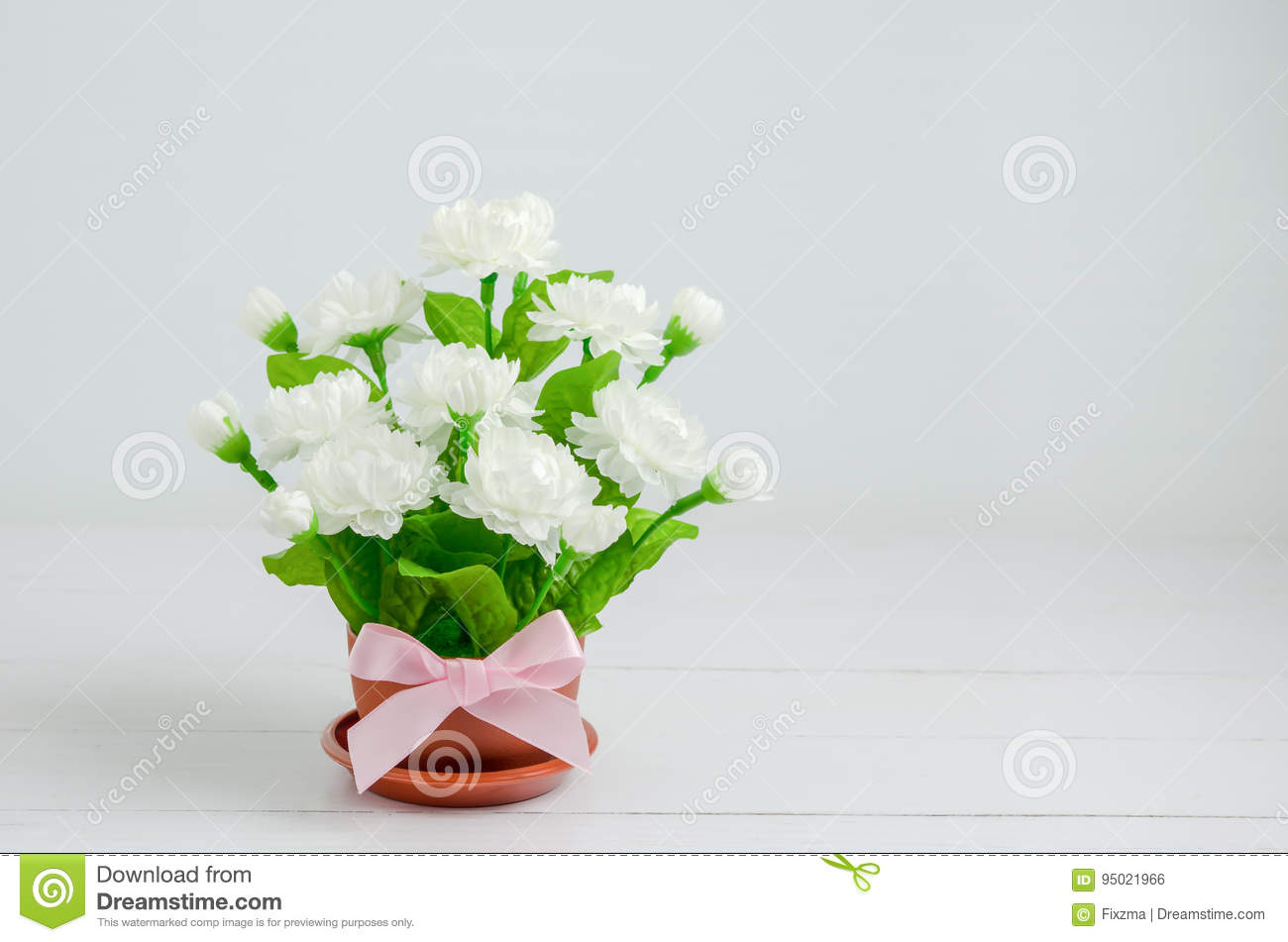 Artificial Jasmine Flower Bouquet With Pink Ribbon Bow Stock Photo ...