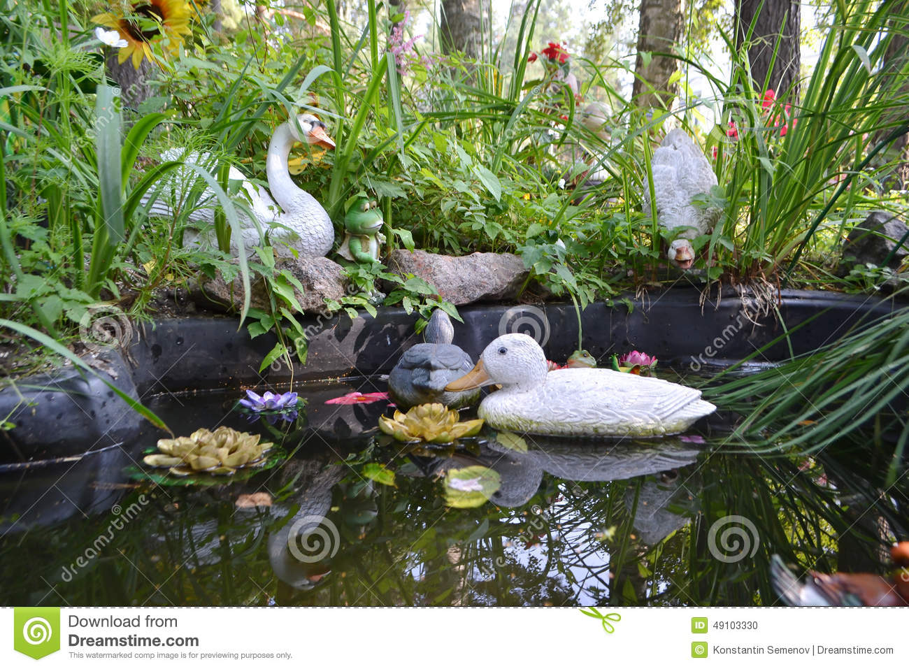 Artificial pond with toy ducks stock photo image 49103330 for Artificial pond water