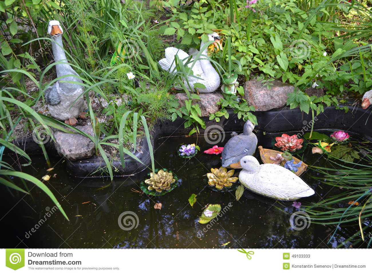 Artificial pond with toy ducks stock image image of for Artificial pond