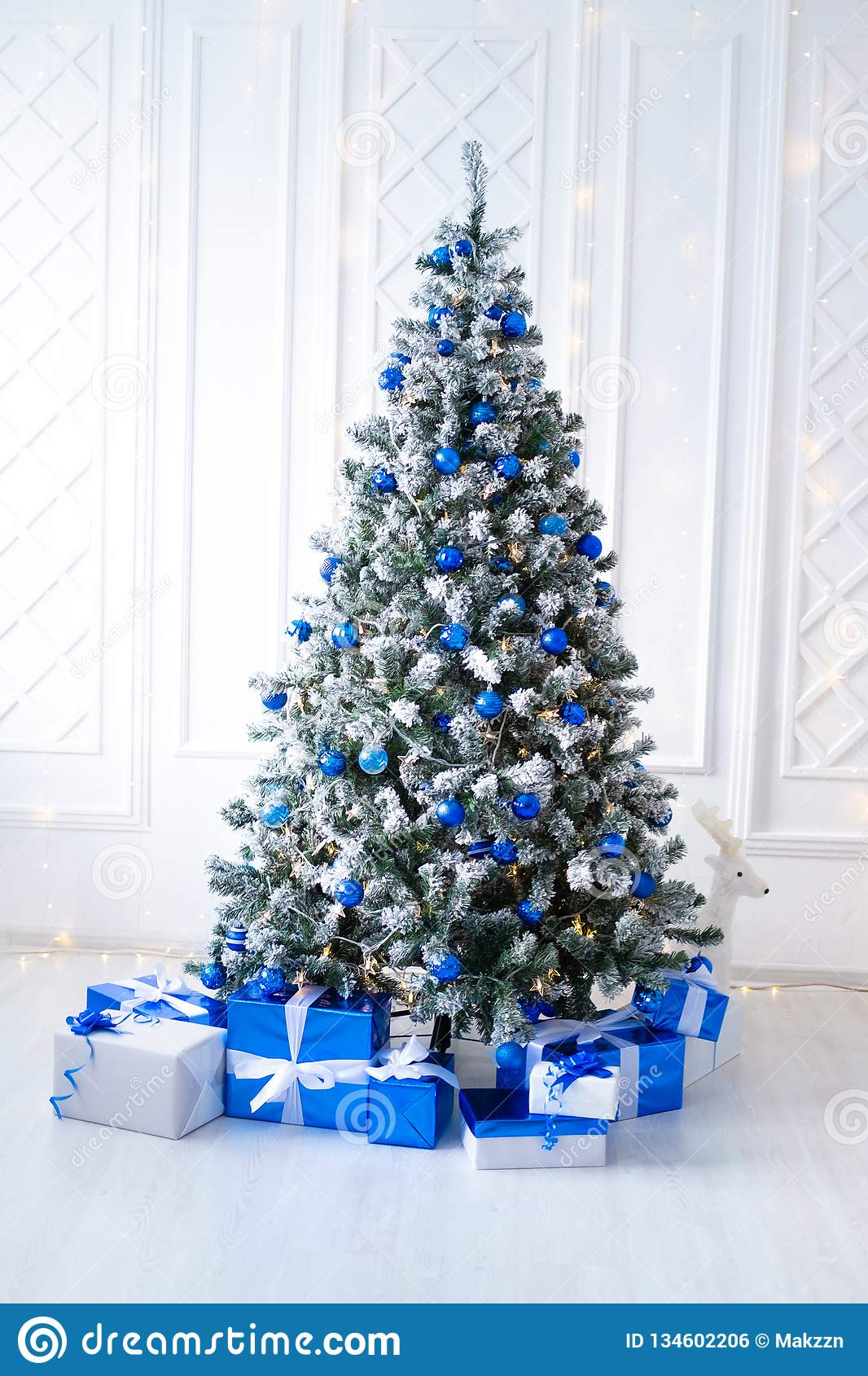 Artificial White Christmas Tree On White Decorated With Blue Ornaments And Garland Modern Christmas Interior Stock Photo Image Of Celebration Christmas 134602206