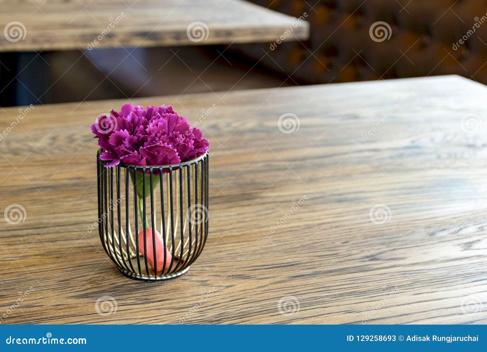 Artificial wood flowerpot on wooden table, small light brown colArtificial wood flowerpot on wooden table, small light brown colou