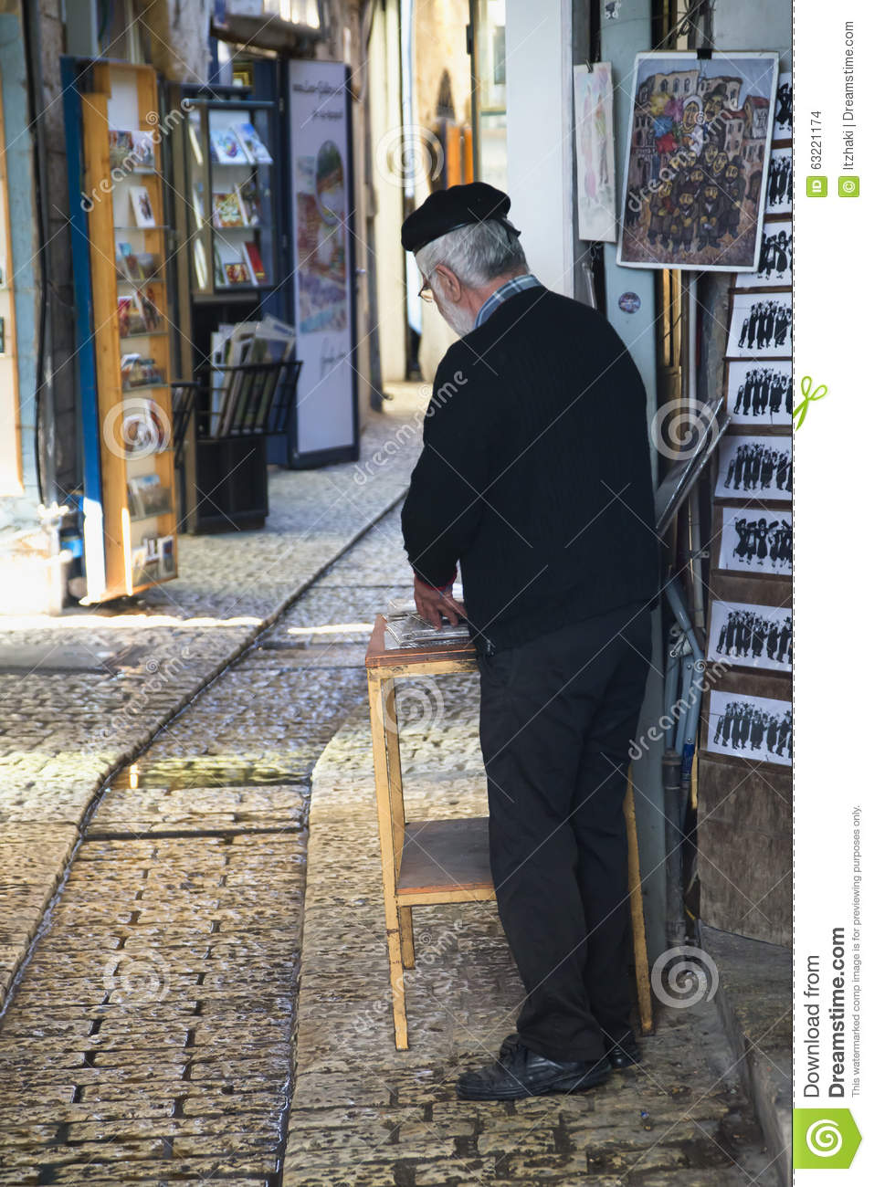 artist in the alley of shops and art galleries in tzfat editorial