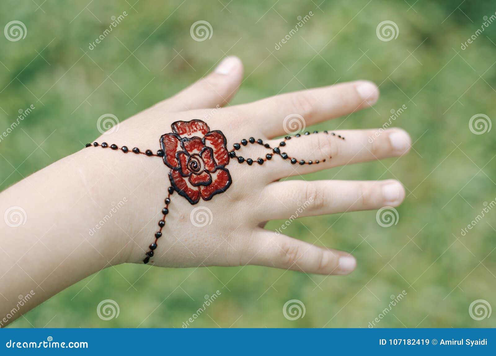 Artist Applying Henna Tattoo On Women Hand Stock Image Image Of