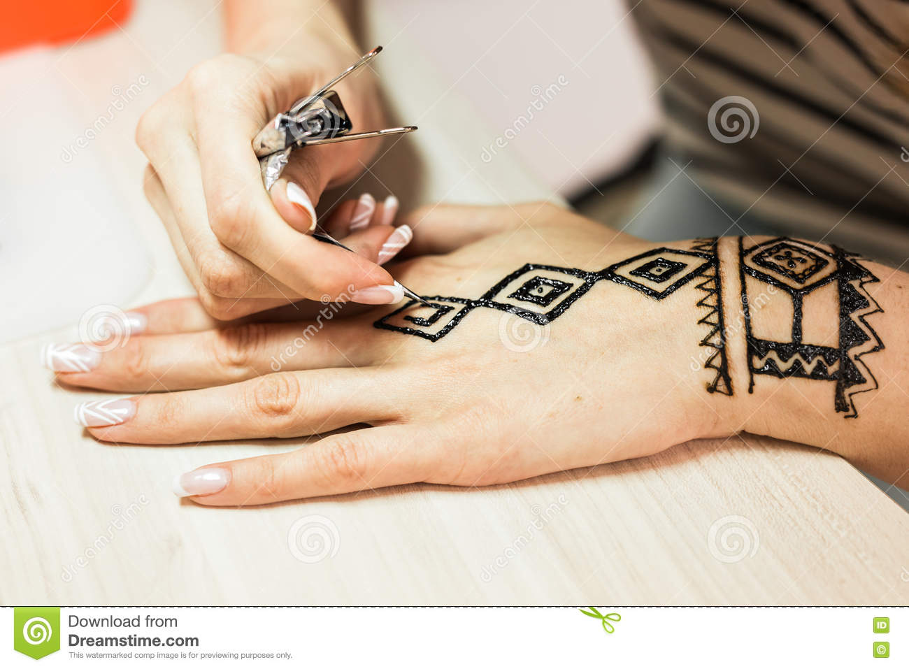 Artist Applying Henna Tattoo On Women Hands Mehndi Is Traditional