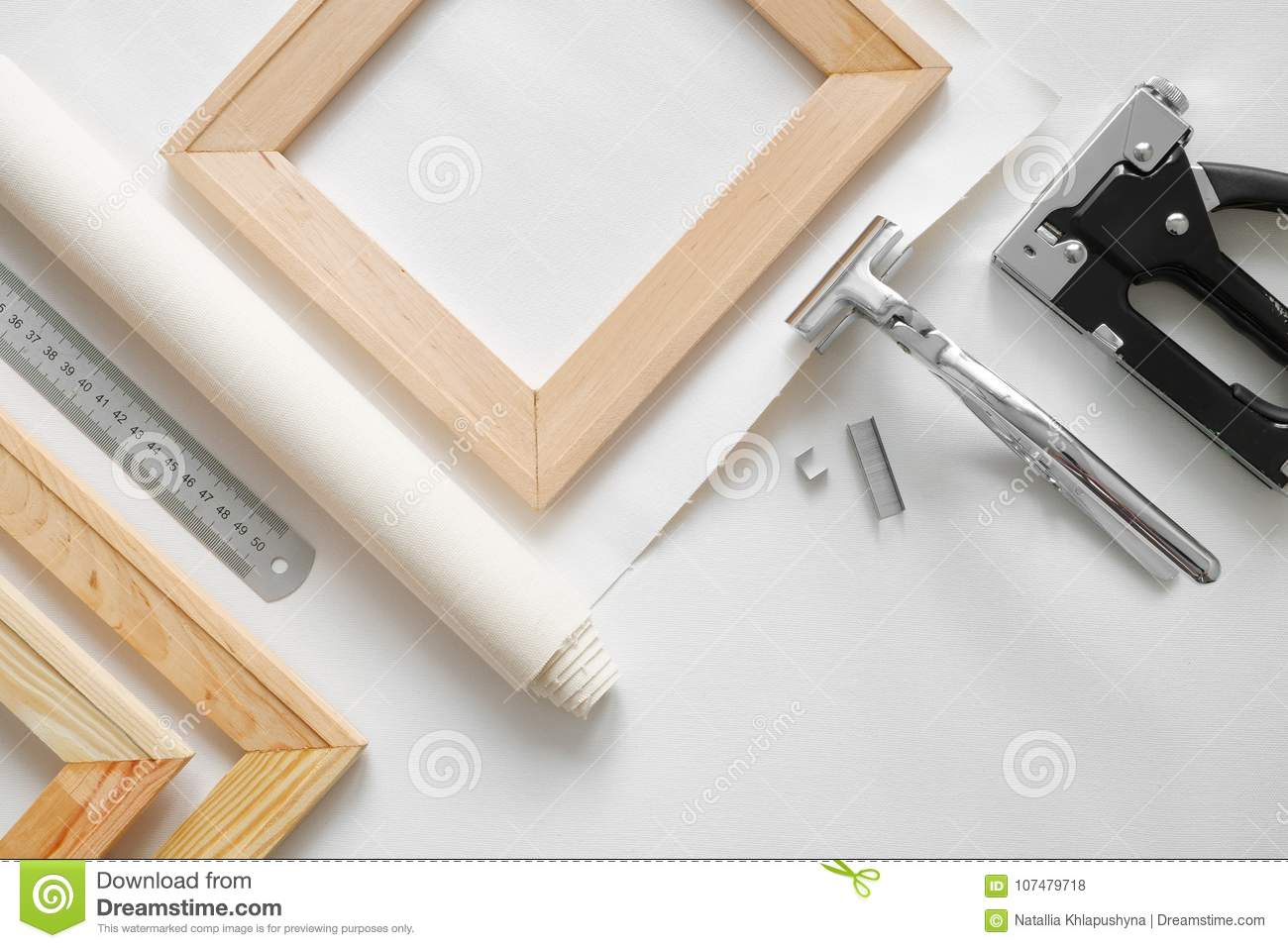 Artist canvas in roll, wooden stretcher bars, canvas stretcher pilers and staple gun.
