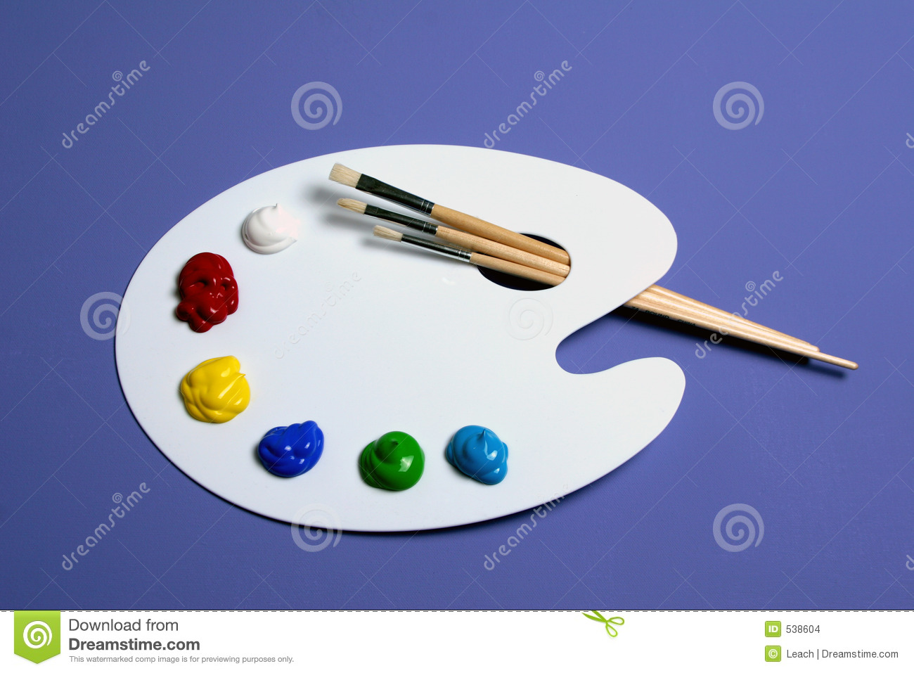 artist paint palette with paints and brushes symbolic of