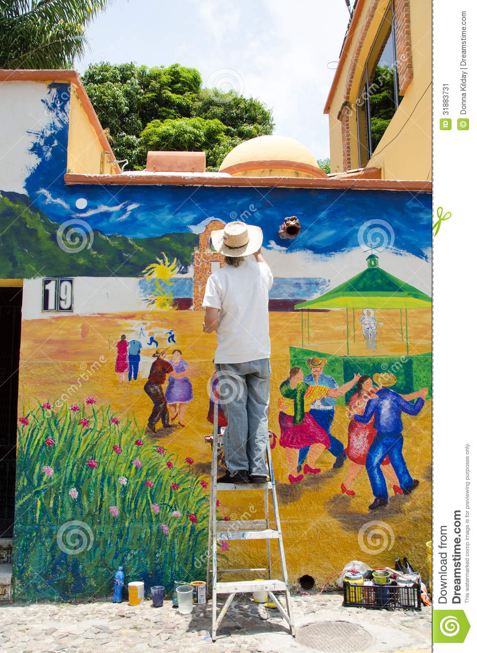 Artist painting outdoor mural editorial photo image for Exterior mural painting