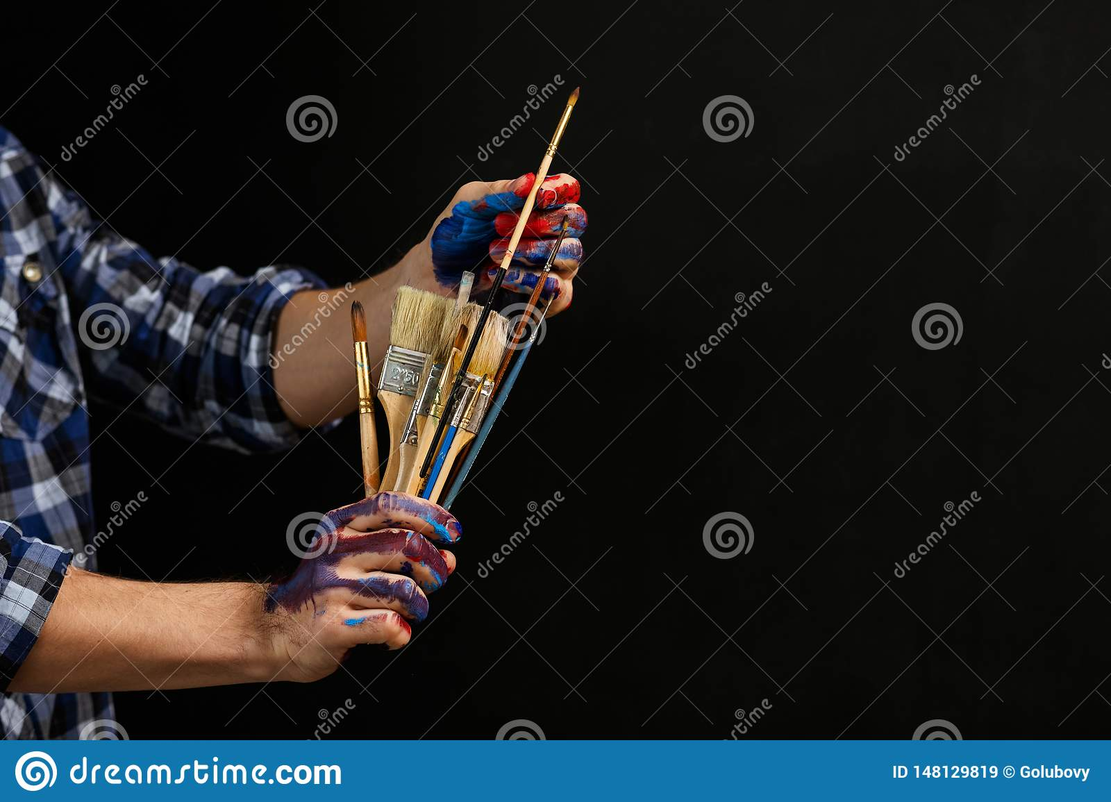 Artist tools paintbrushes man hands art lifestyle