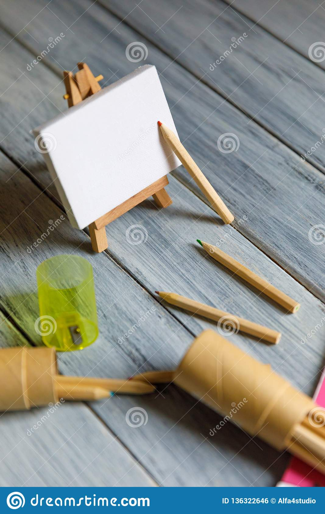 Artist workplace : White table of an artist with art tools for drawing