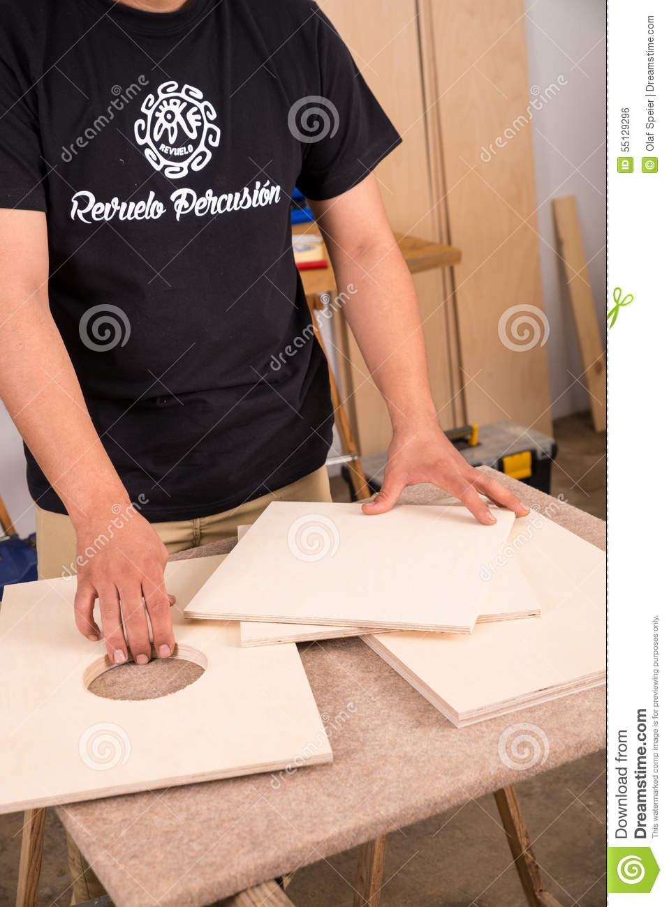 artistan assembling a precussion instrument stock photo image of