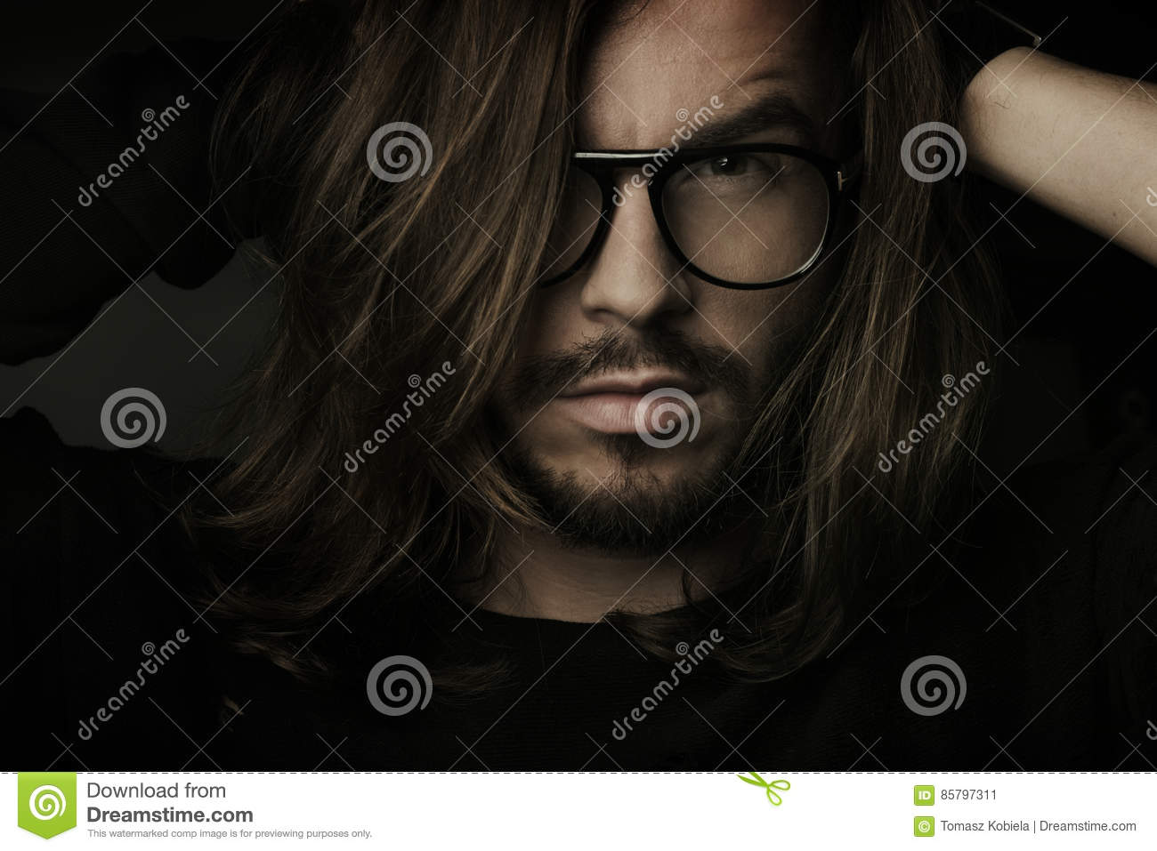 Artistic dark portrait of the young beautiful man