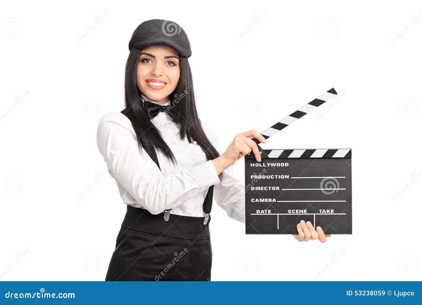 artistic female director holding a movie clapper board