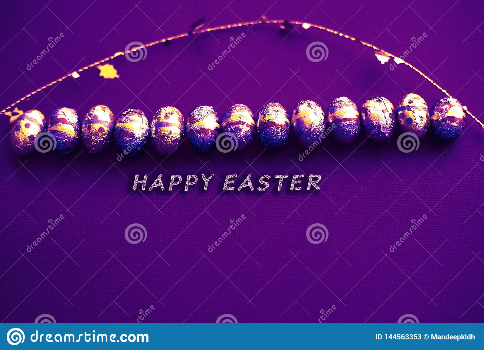Easter greeting card. Easter eggs card with golden confetti on surface. Festive stylish wallpaper. Pastel sheets luxurious theme.