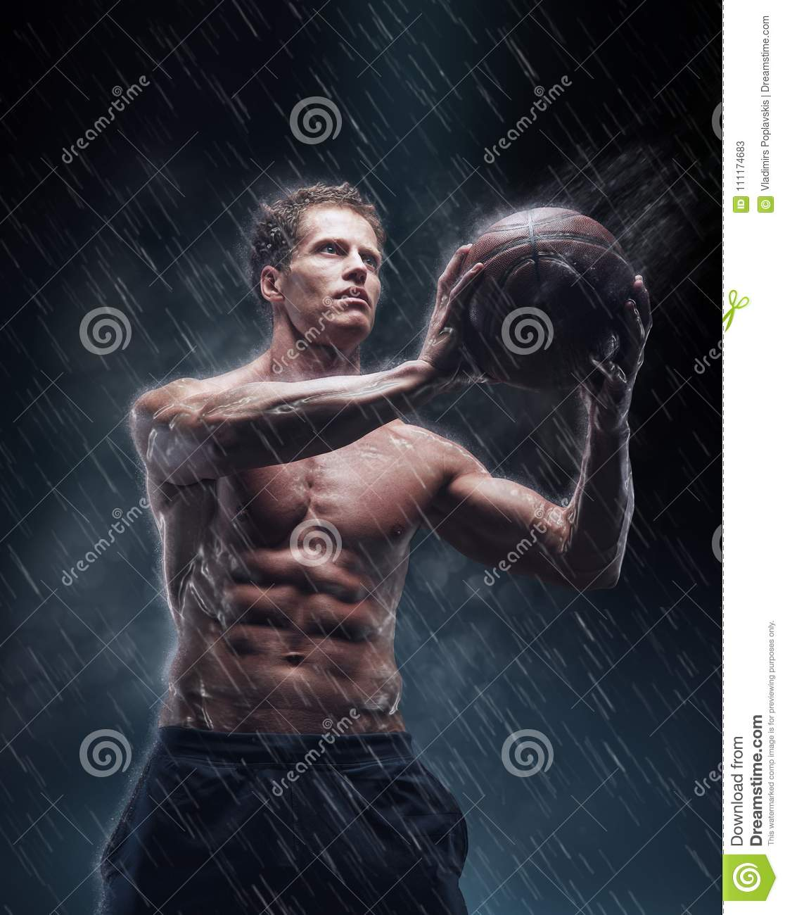 Portrait of shirtless wet bascetball player.