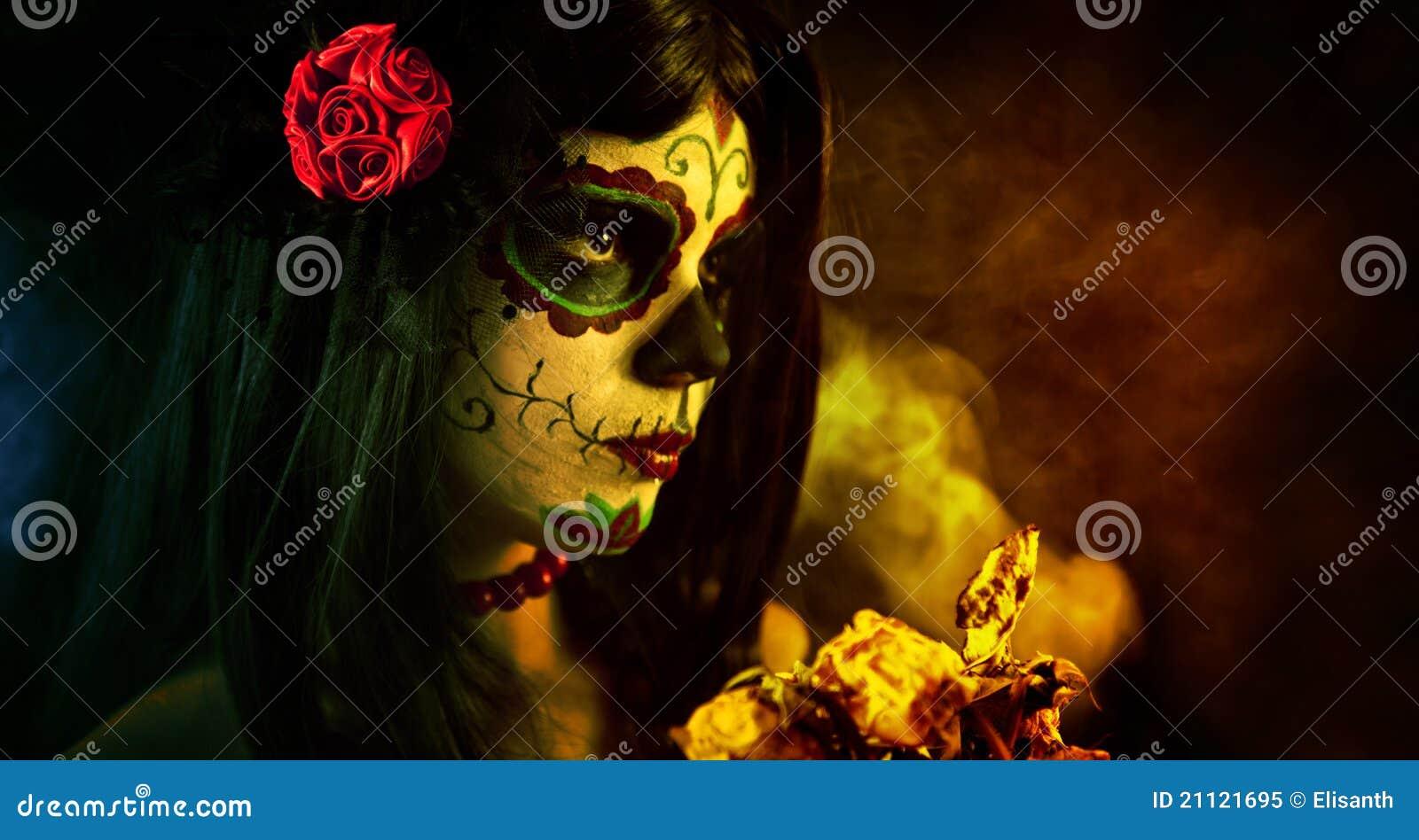 Artistic shot of sugar skull girl with dead roses