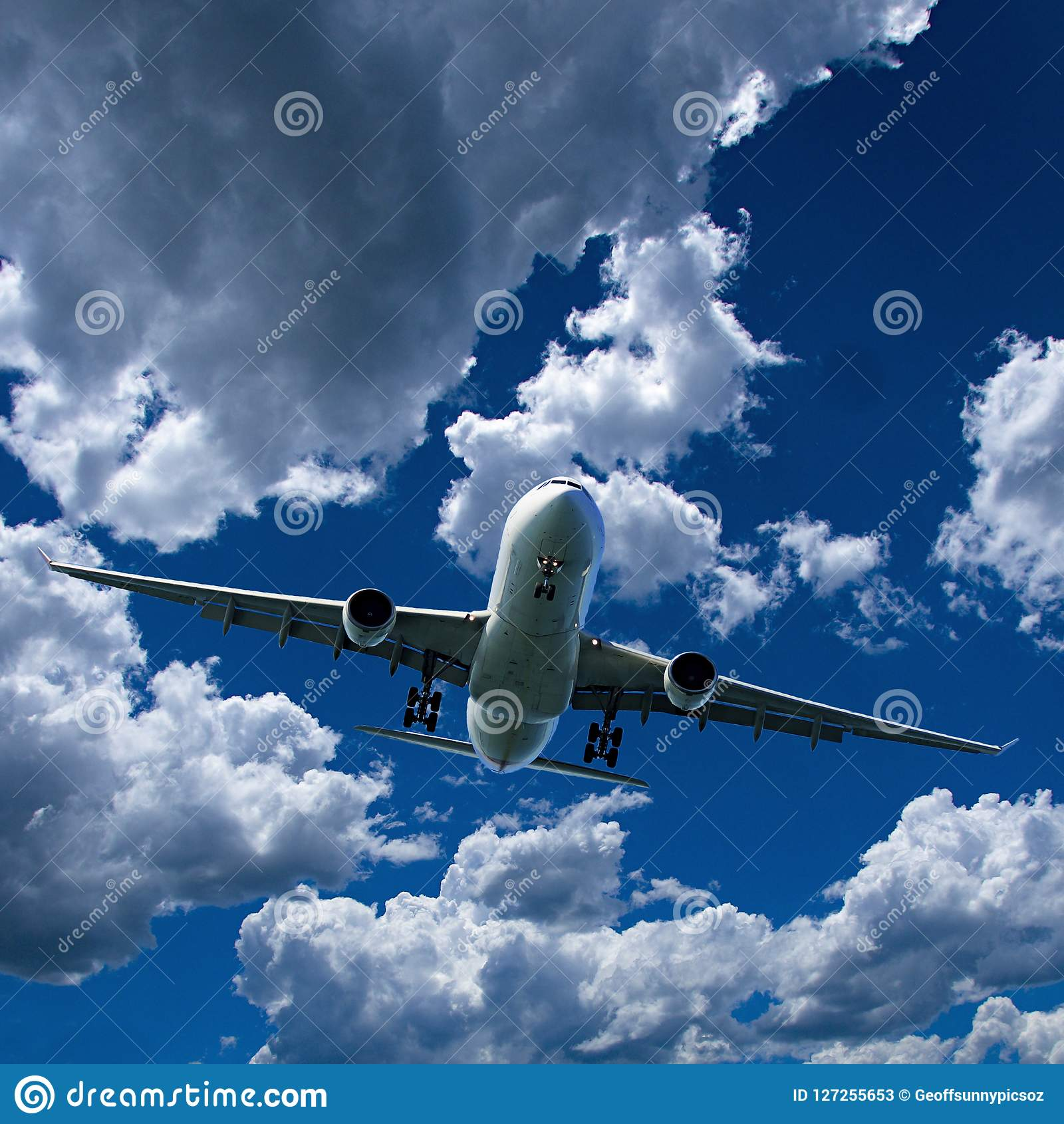 Airliner in flight with Cumulus cloud in blue sky. Australia.