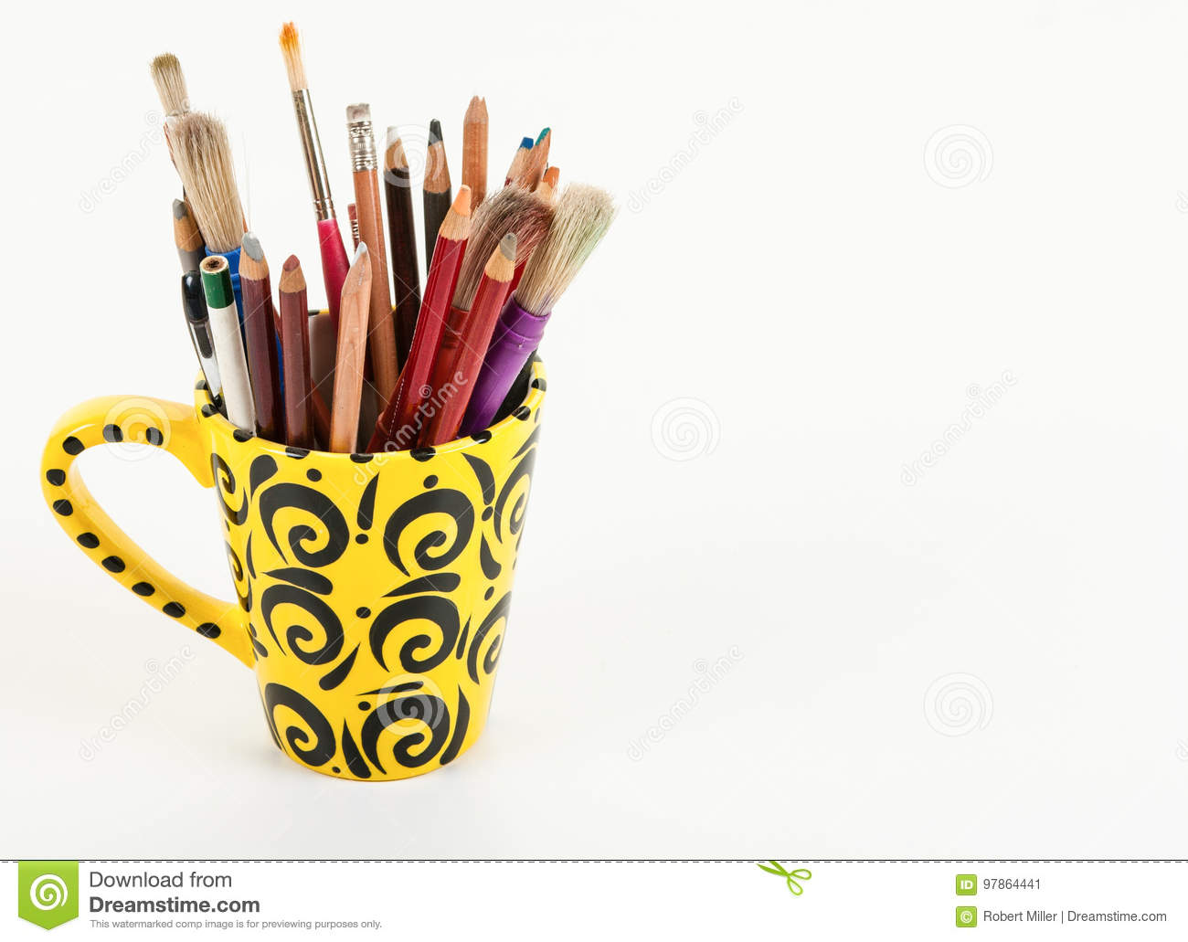 an artistic yellow cup with art supplies stock image image of