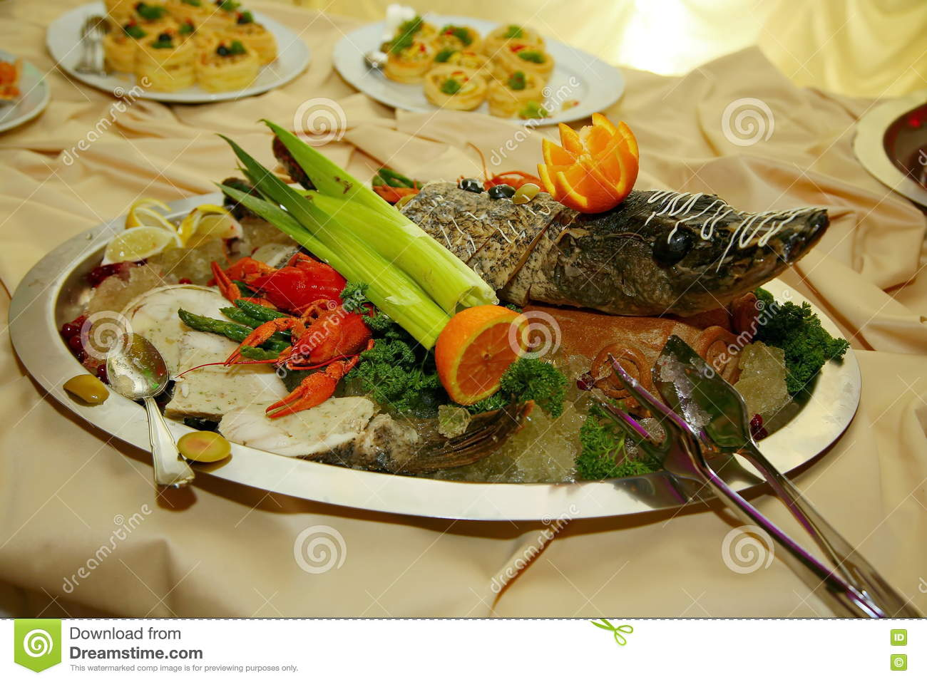 Artistically decorated with Gefilte fish sterlet baked entirely is a delicacy from the chef - a dish of venison.