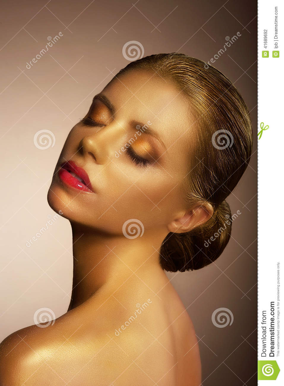 Artistry. Fanciful Bronzed Woman s Face. Futuristic Art Gold Makeup