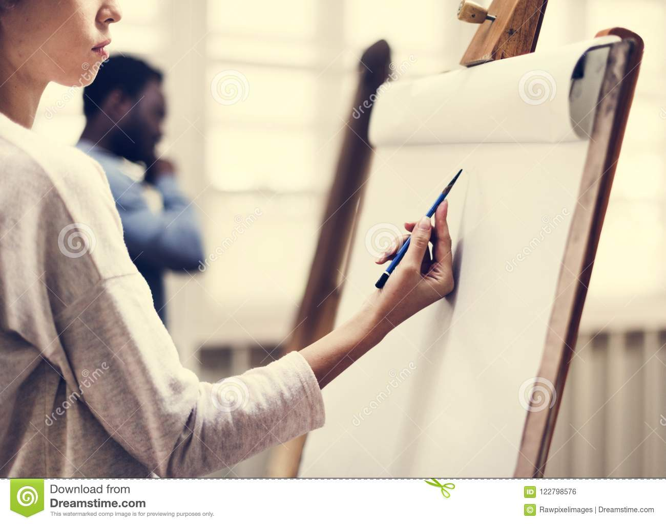 Artists drawing in art class