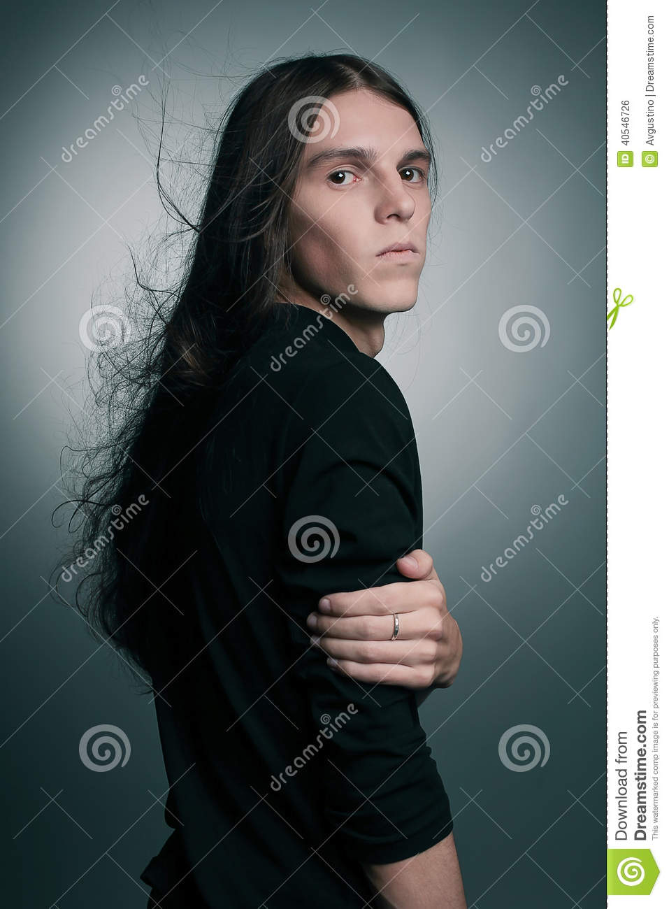 Arty portrait of a fashionable male model with long hair