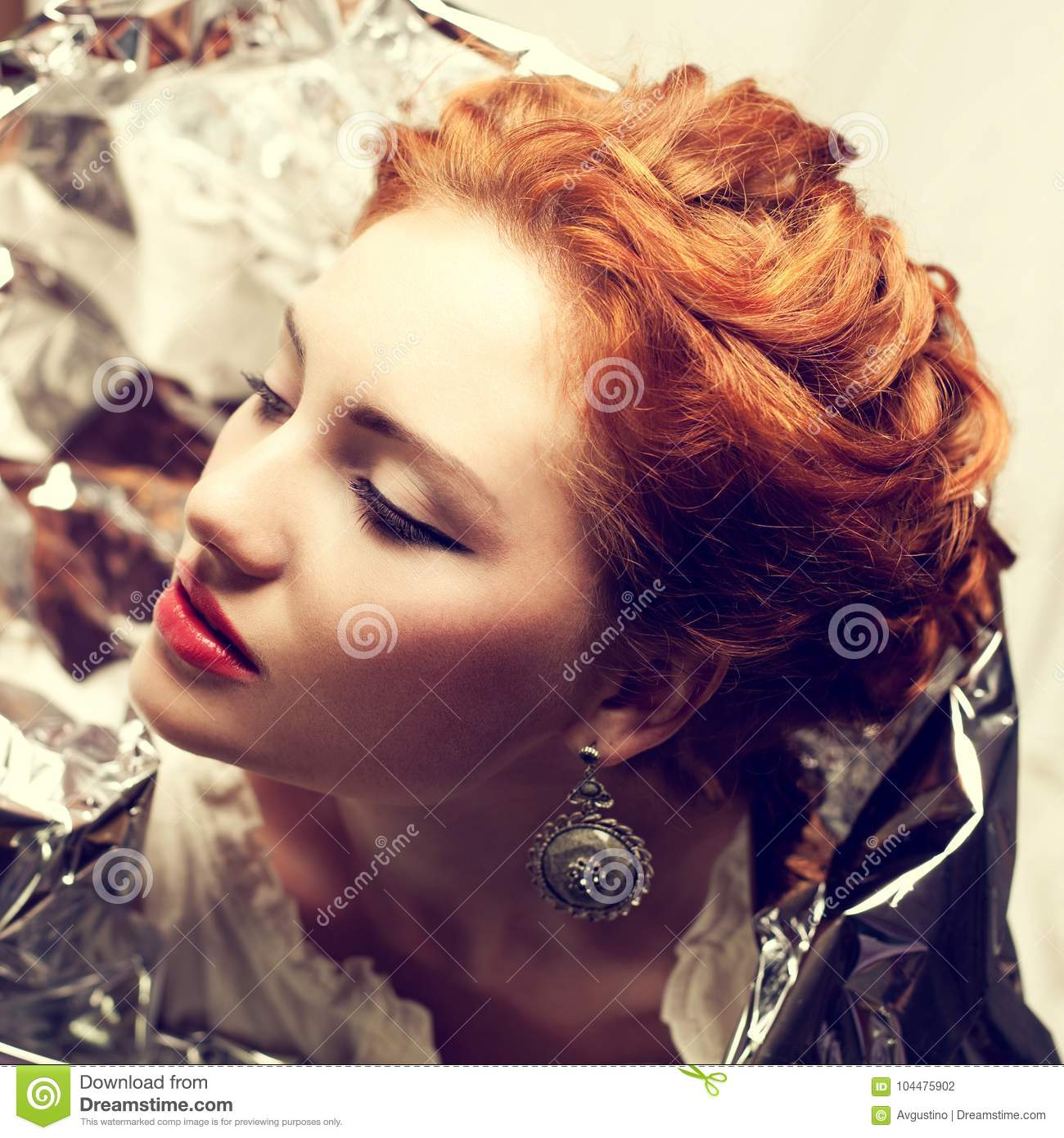 Arty portrait of fashionable queen-like red-haired queen