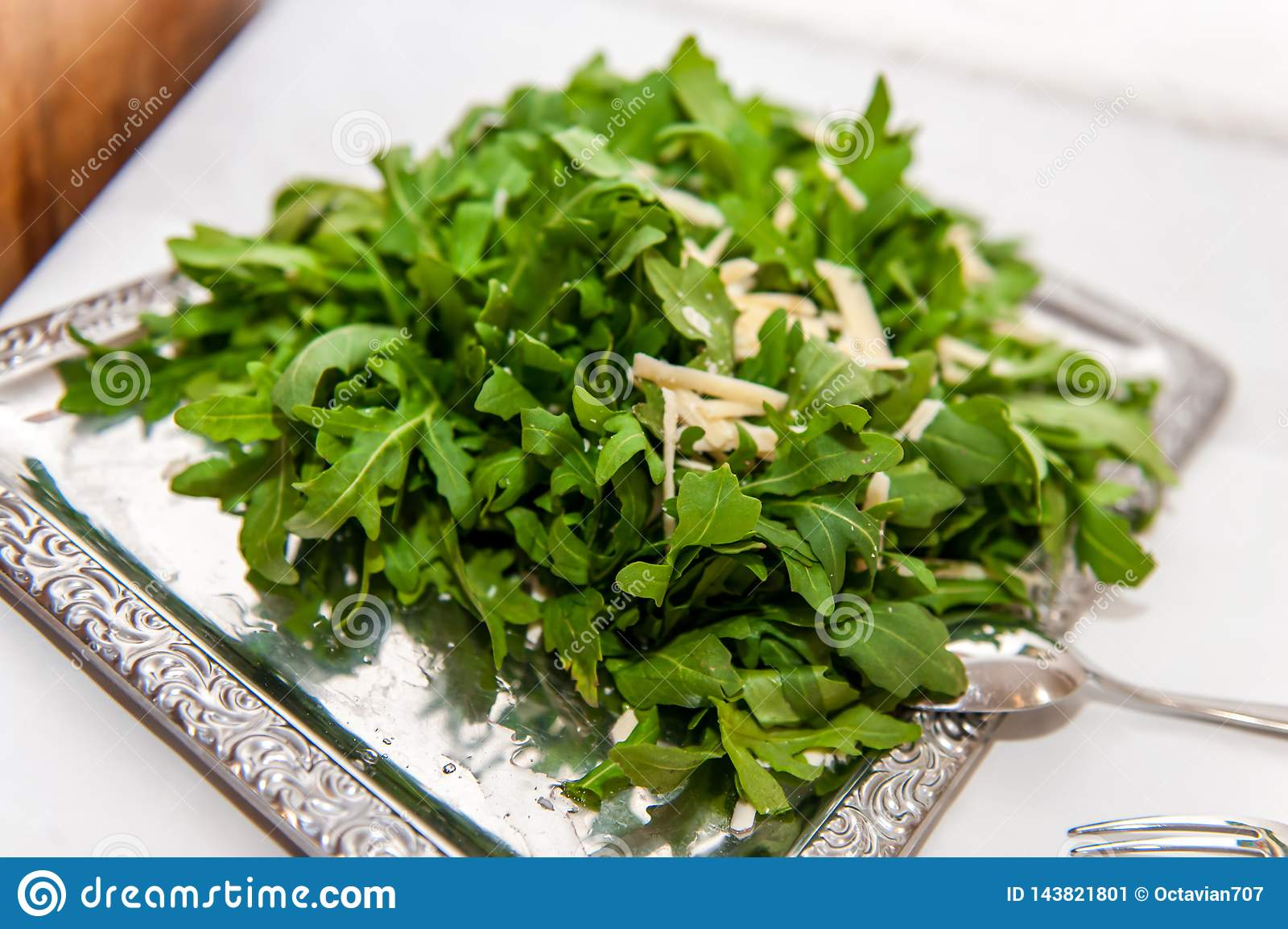 Arugula salad on silver platter