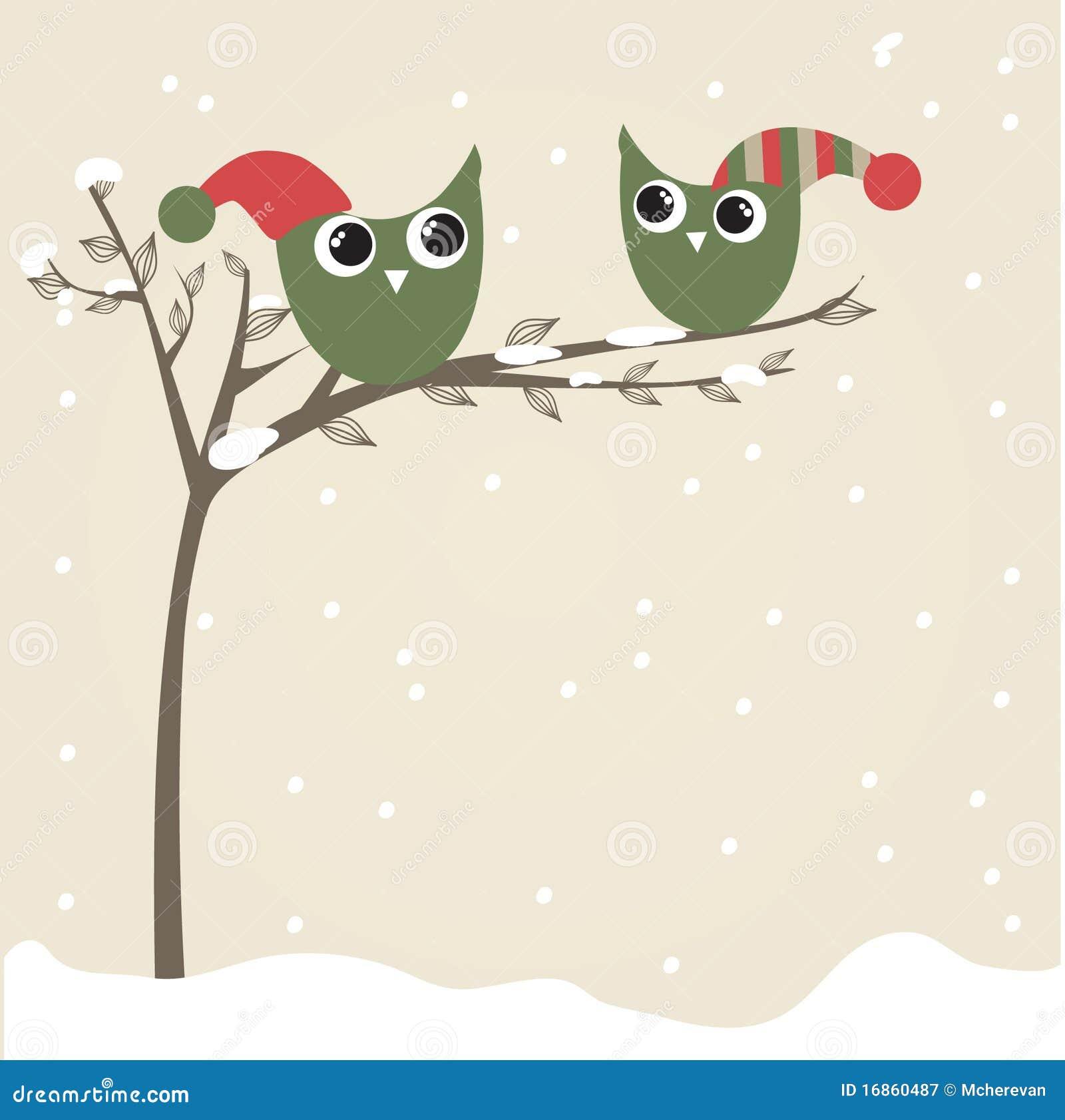 As corujas acoplam-se em chapéus do Natal na filial de árvore