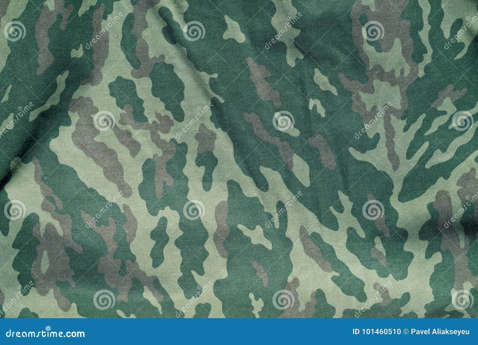 As forças armadas verdes e marrons camuflam o teste padrão uniforme