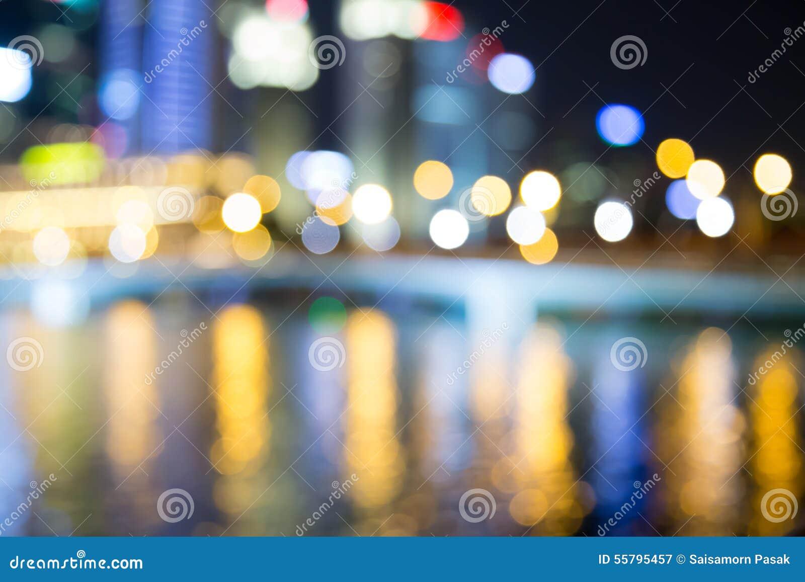 As luzes da noite da cidade de Singapura borraram o bokeh