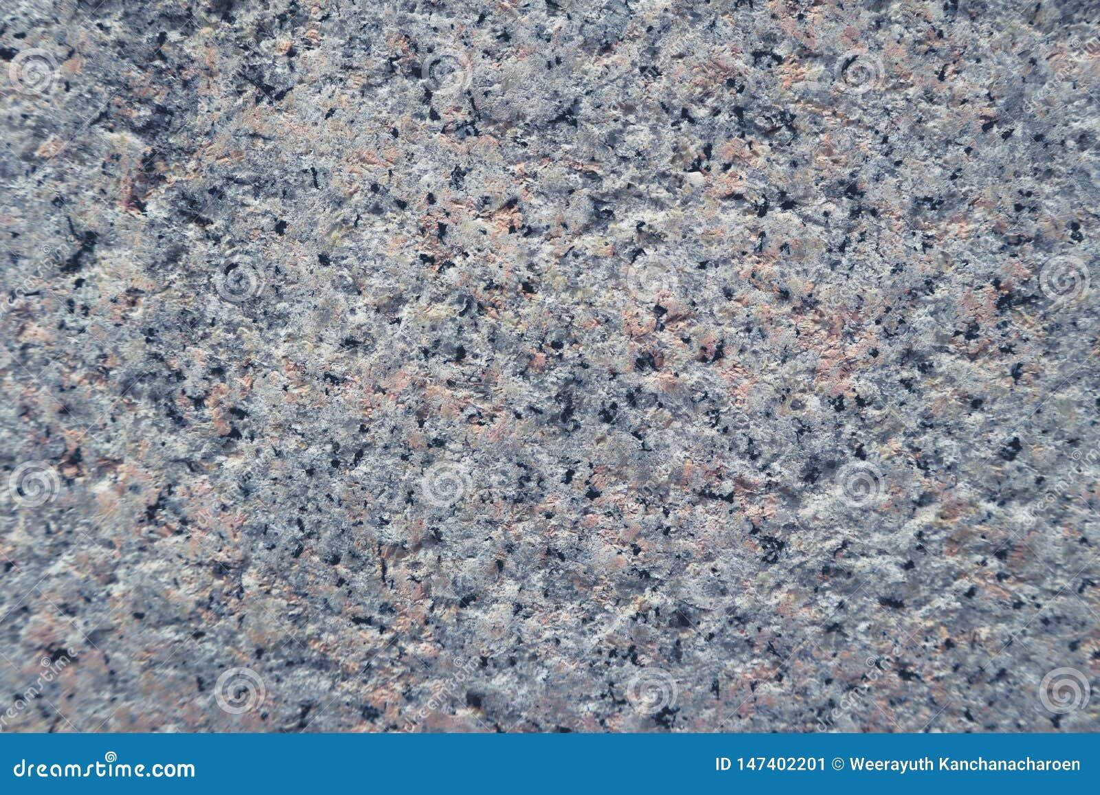 As texturas bonitas do close up abstraem o fundo da parede e o assoalho velhos do cimento