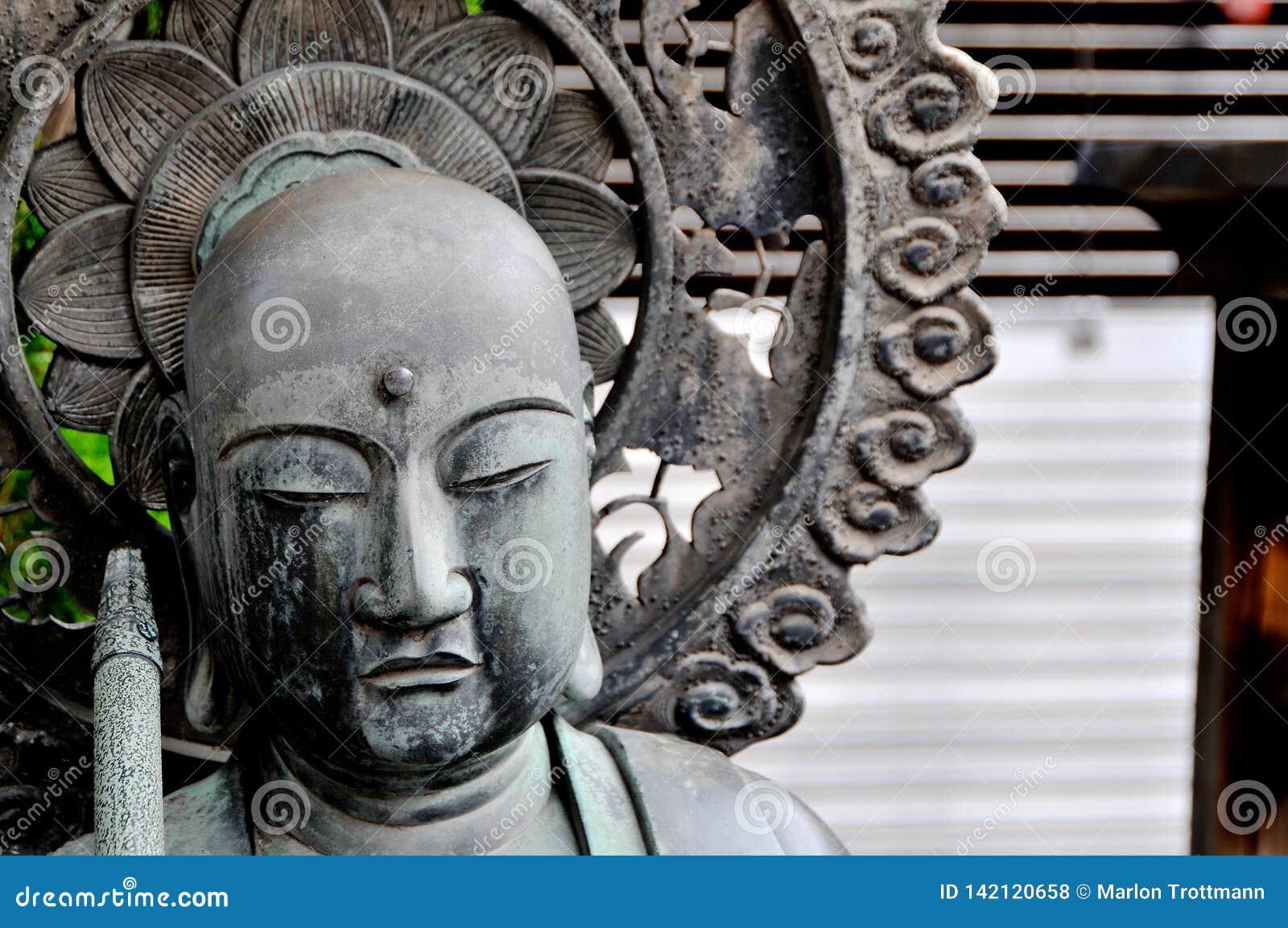 Close up picture of the Jizo Bosatsu statue at the Senso-ji Temple in Tokyo, Japan