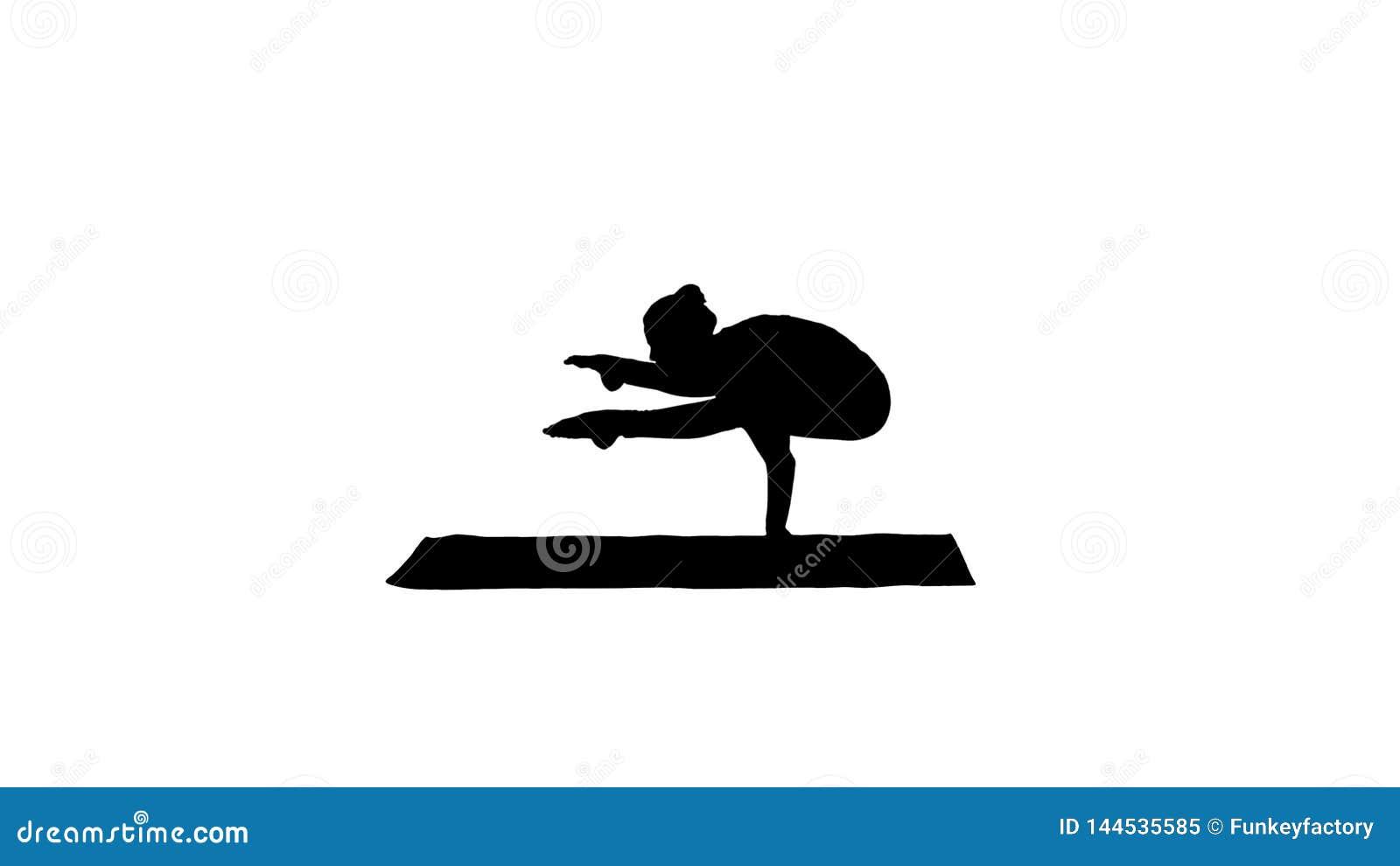 Asana hermoso Tittibhasana - actitud de la yoga de la posici?n del pino de las pr?cticas de la mujer de la silueta de la luci?rna