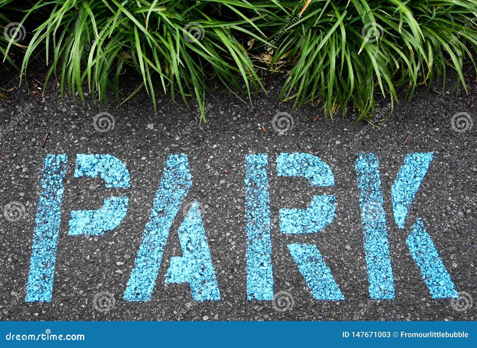 Asfalt som målas med, parkerar i blått