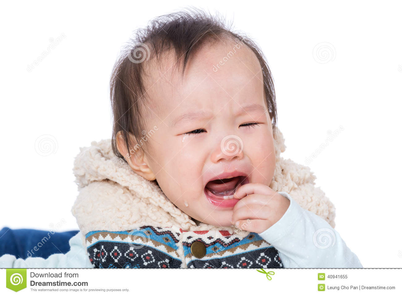 asian baby girl crying and suck finger into mouth royalty
