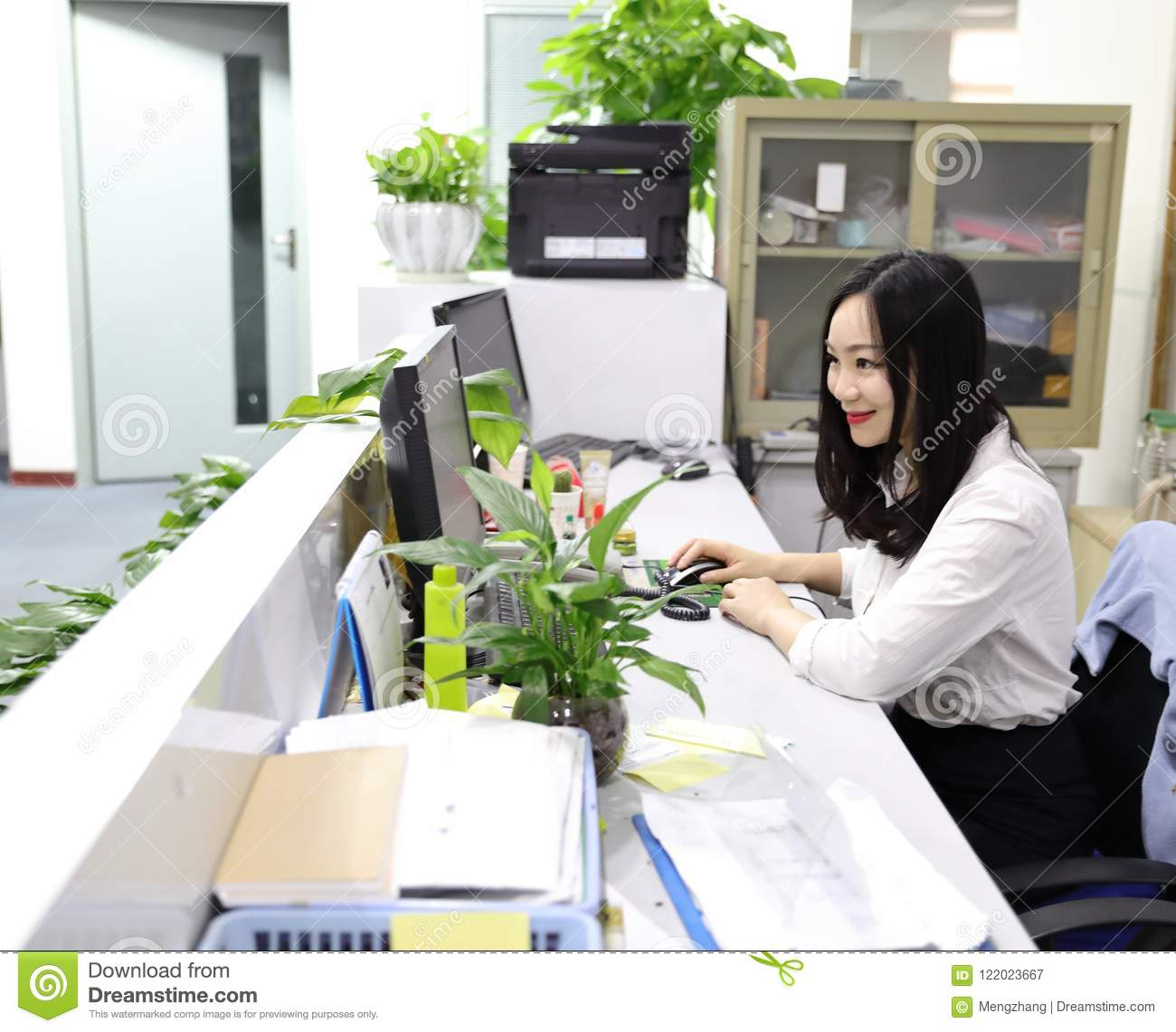 asia chinese office lady woman girl at work smile look at computer