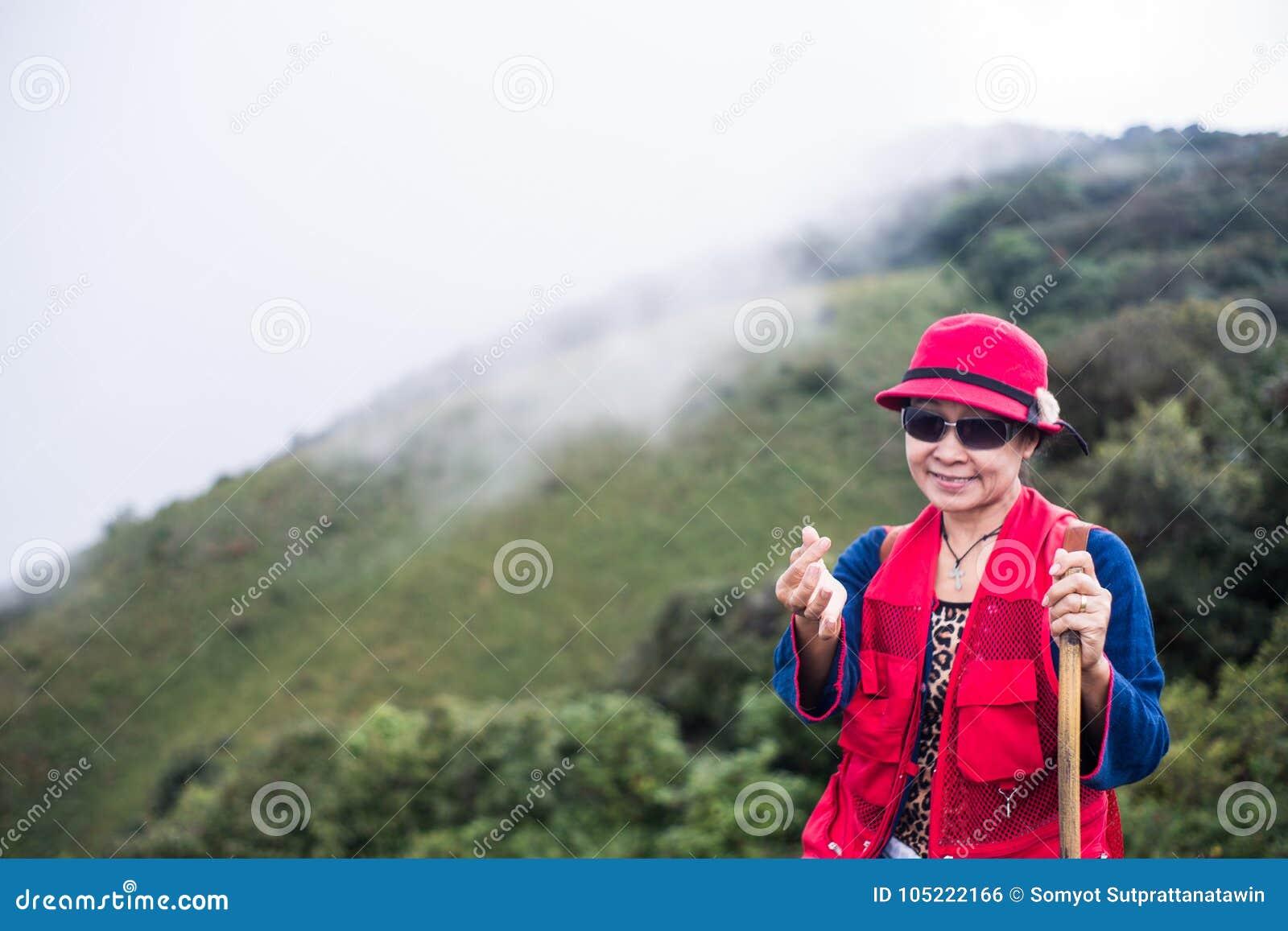 Asia trekker woman in red