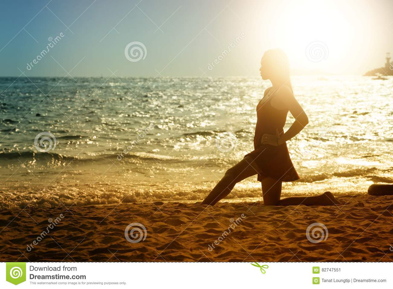 Asia Young woman in summer dress standing on beach