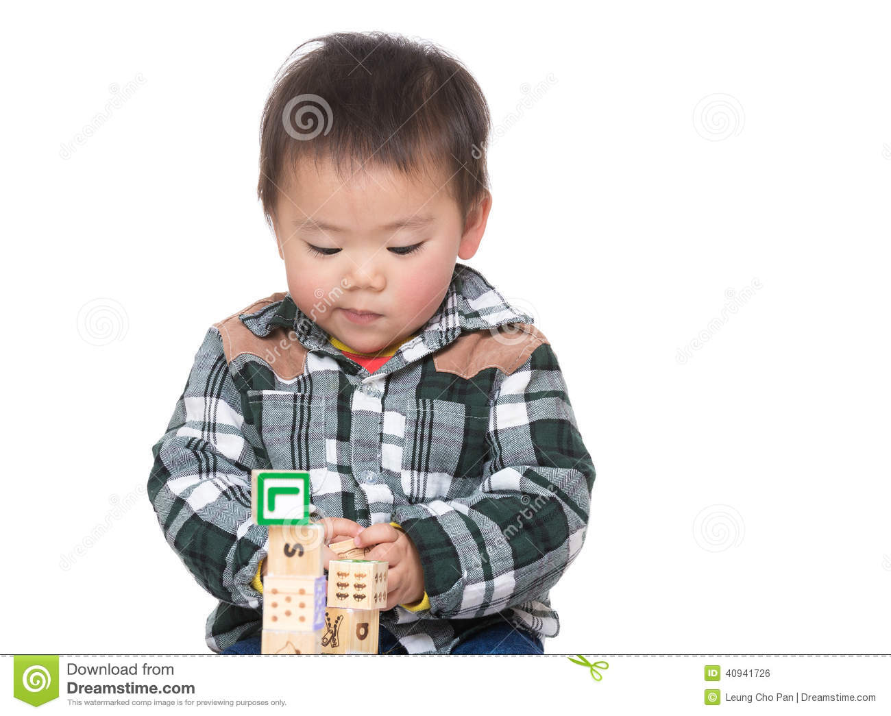 White Boys Toys : Asian baby boy concentrate on playing toy block stock