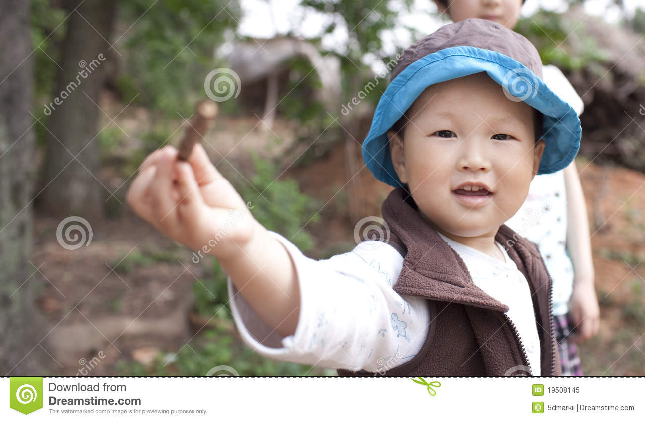 Asian baby boy playing in the garden royalty free stock photo image