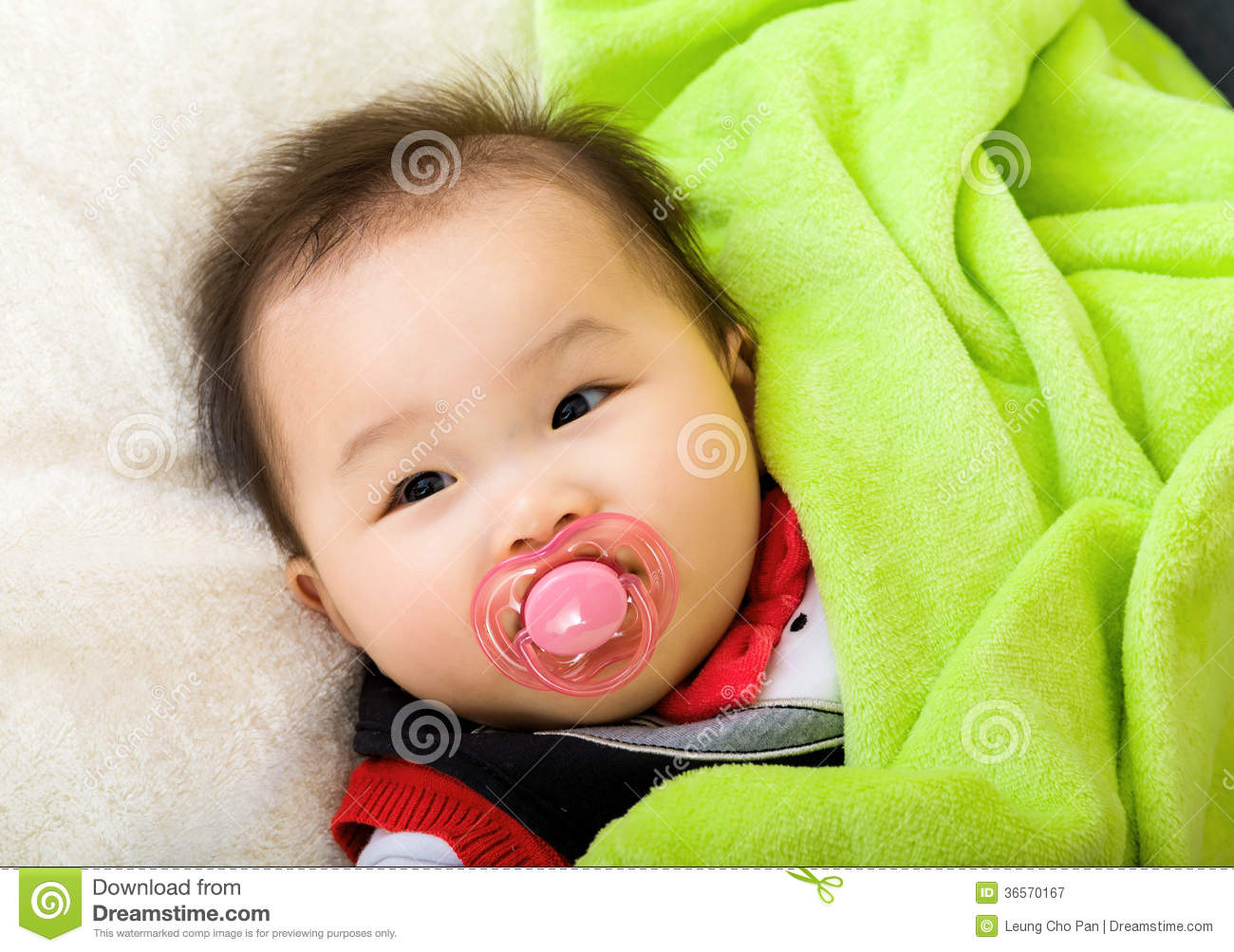 Asian baby with pacifier