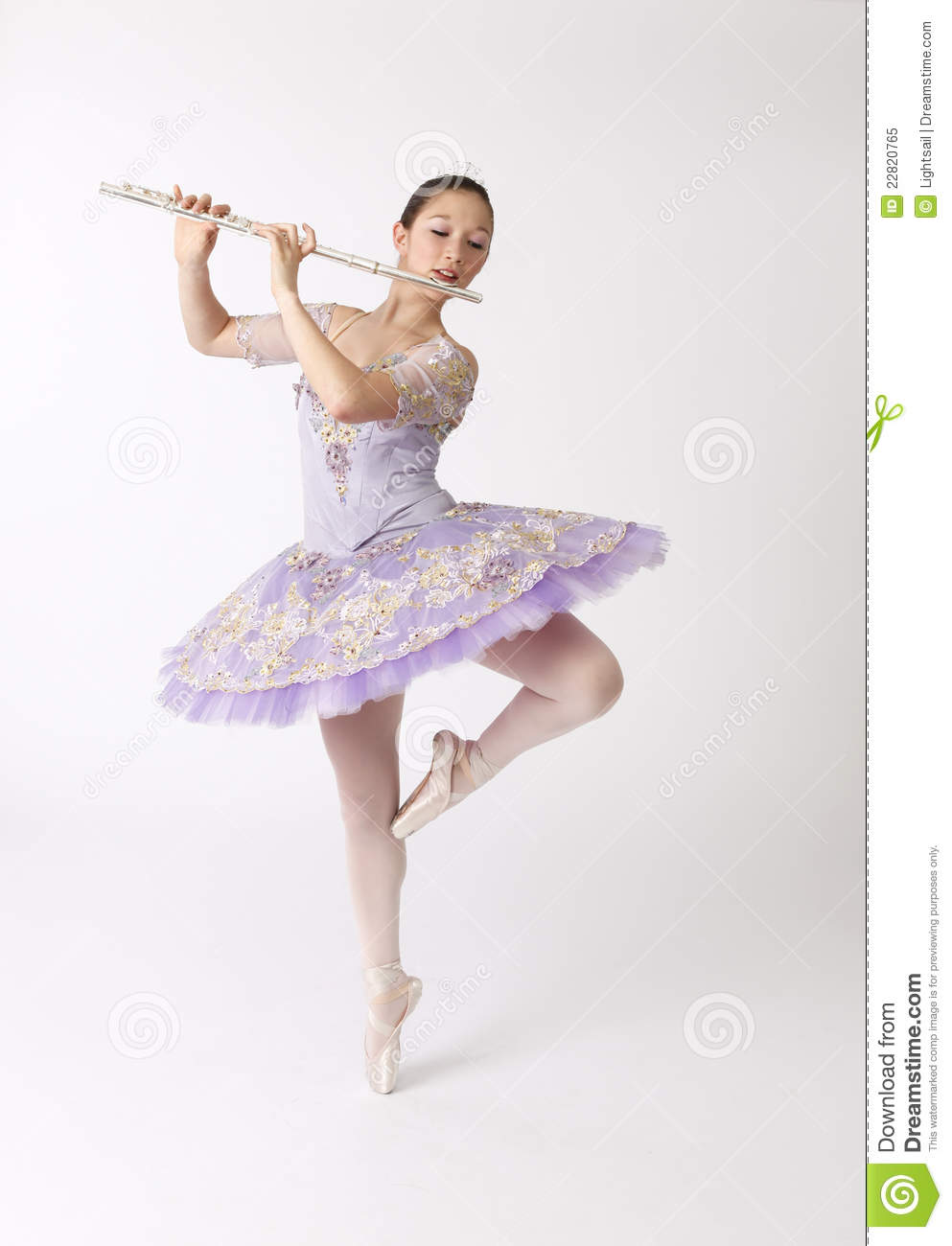 Asian Ballet Dancer On Pointe Playing Flute Royalty Free Stock Photo ...