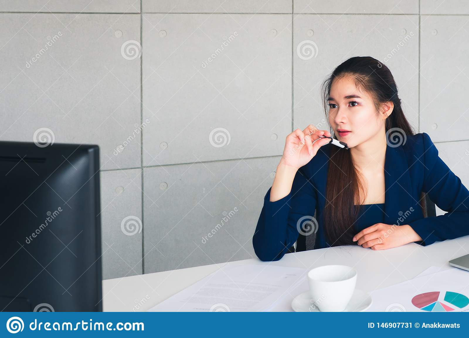 Asian beautiful business woman have worry in her thinking