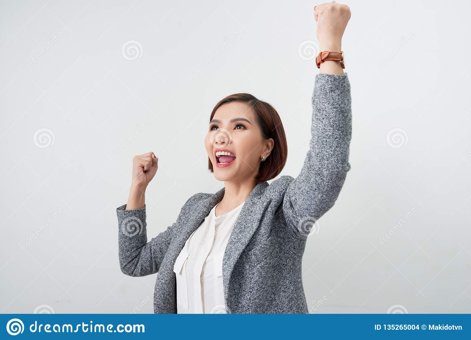 Asian beautiful girl feel happy. smiling woman show hand up successful sign action