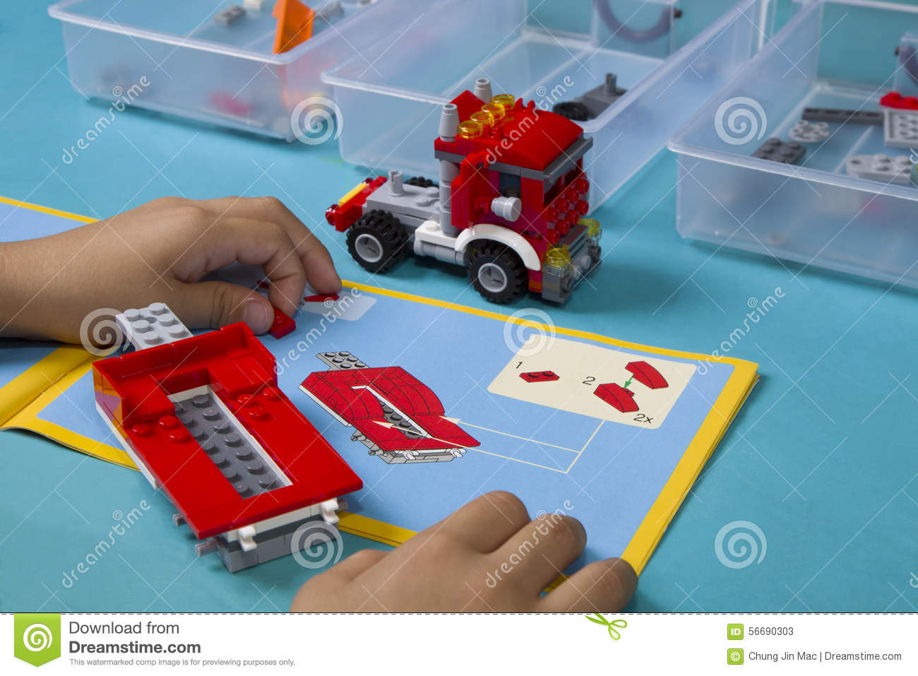 Asian Boy Builds Lego With Instruction Manual Editorial Stock Photo