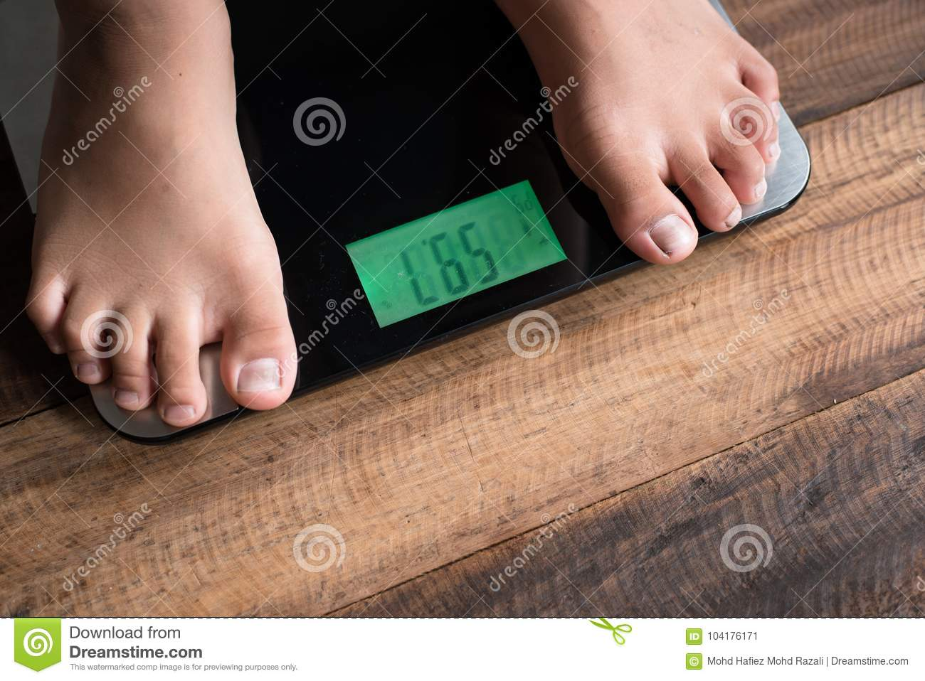 asian boy feet on a weighing scale stock image - image of concept