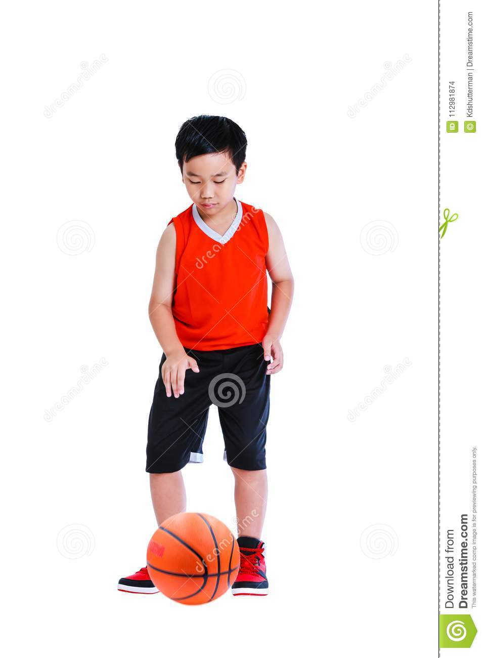 Asian boy playing basketball. Isolated on white background.